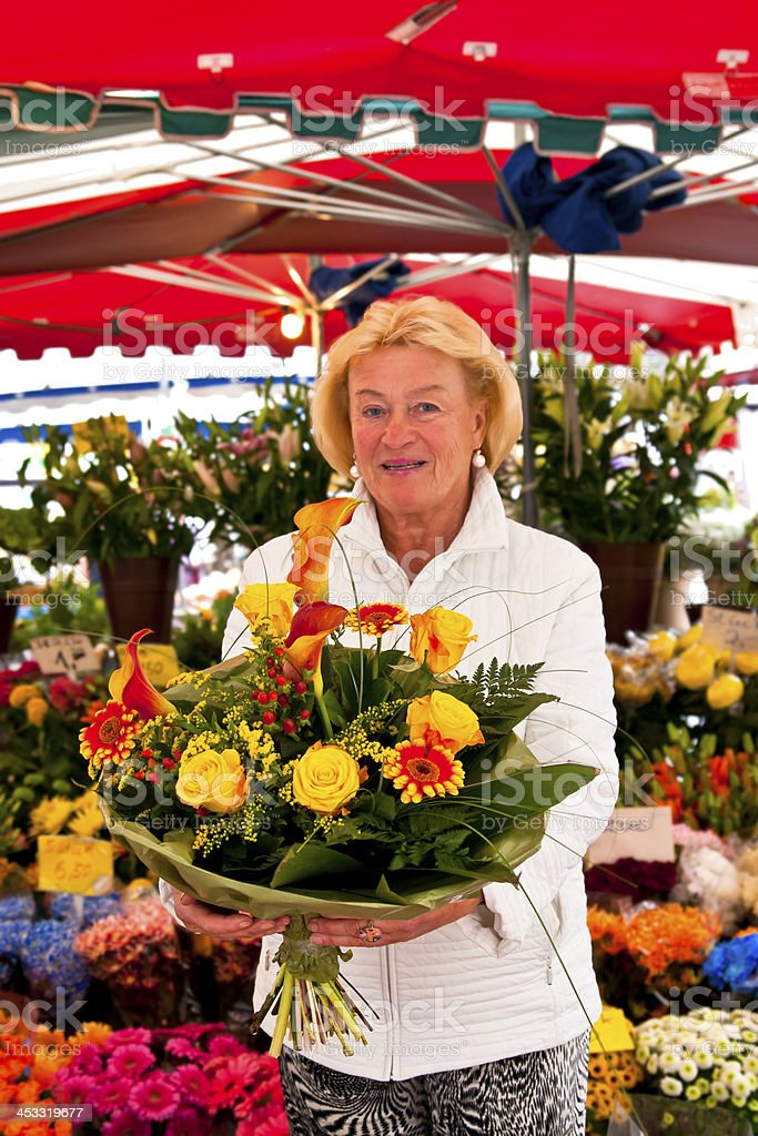 Senior Female Florist with Bouquet royalty-free stock photo