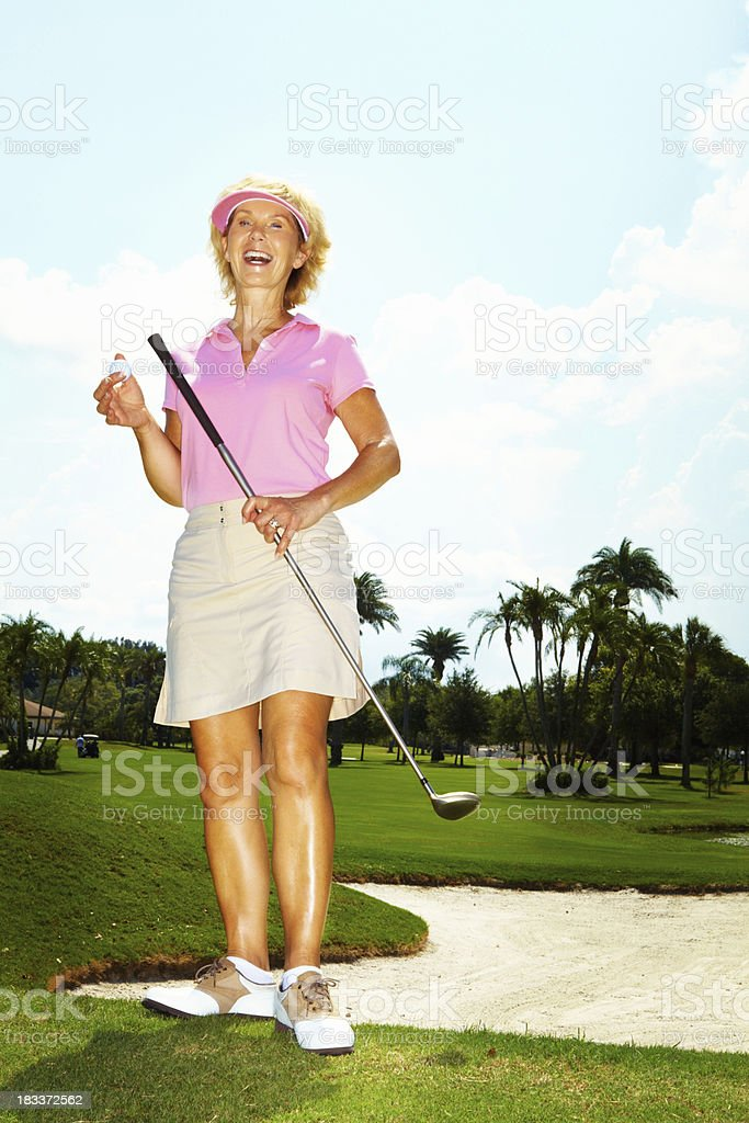 Senior female golfer royalty-free stock photo