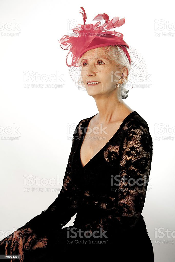 Senior Female In A Red Hat royalty-free stock photo
