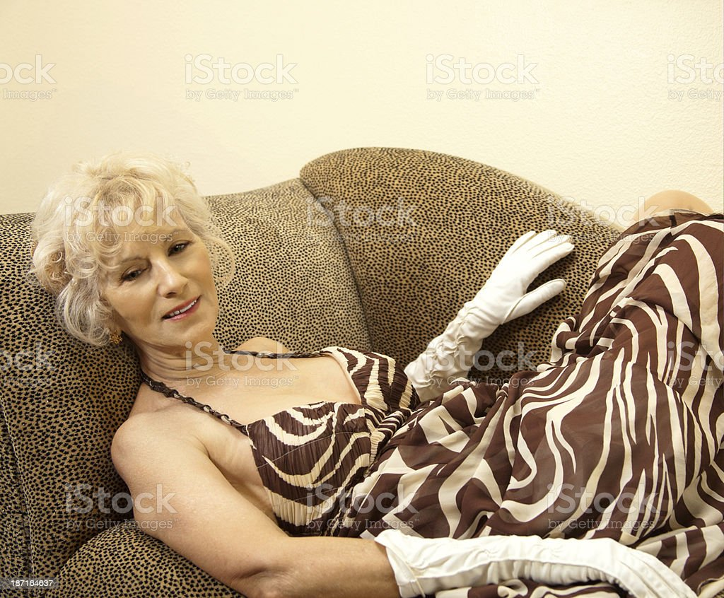 Senior Female Lying On A Couch royalty-free stock photo