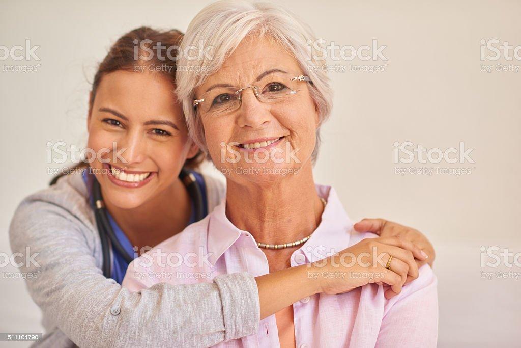 Senior female patient with nurse stock photo
