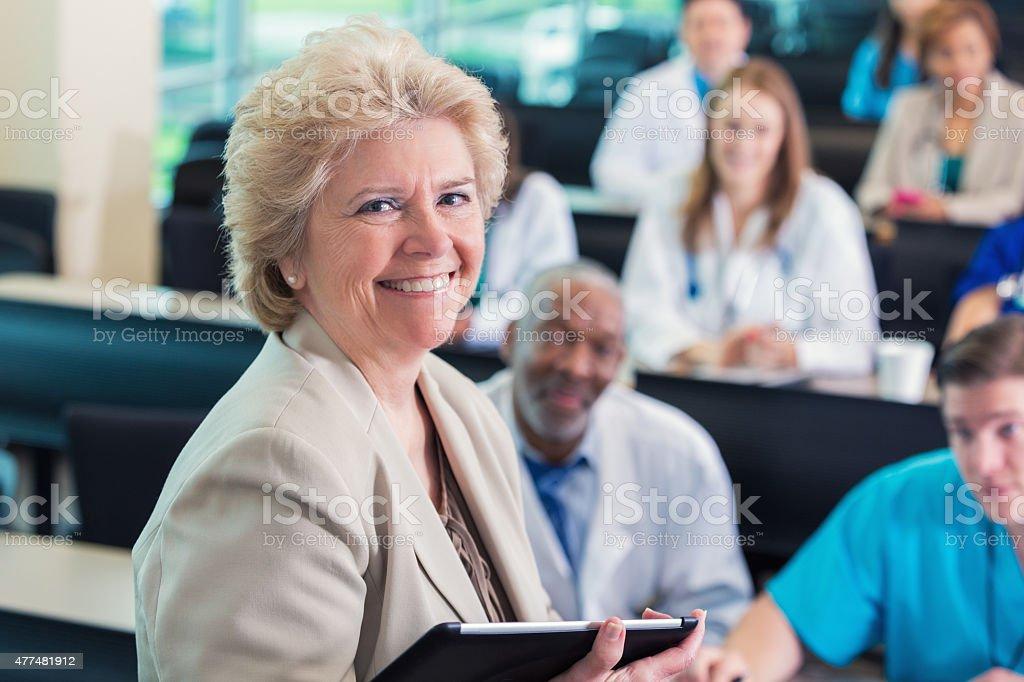 Senior female professor teaching in nursing or medical school stock photo