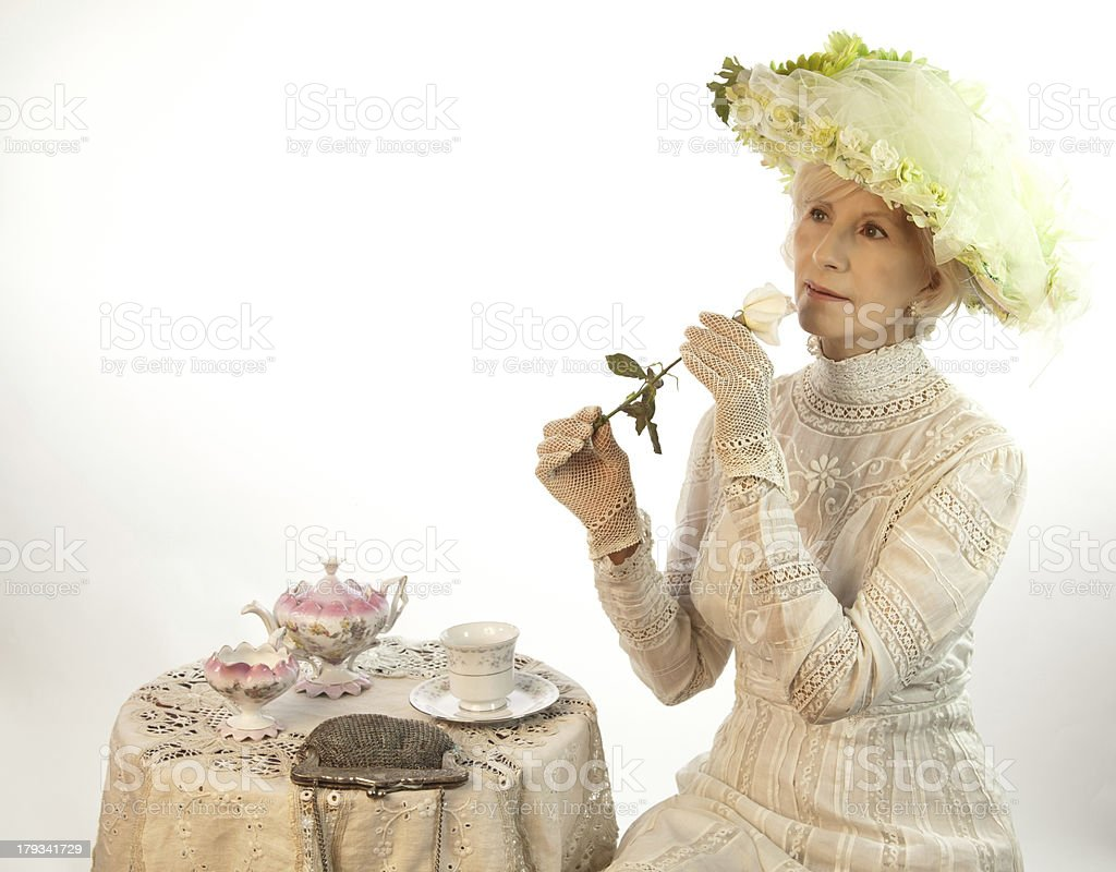Senior Female Smelling A Rose royalty-free stock photo