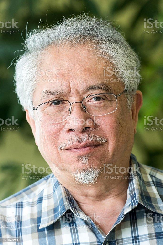 Senior filipino man stock photo