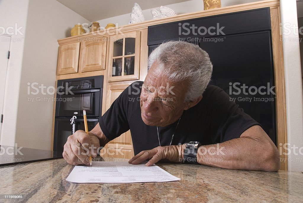 Senior filling out generic health history form stock photo