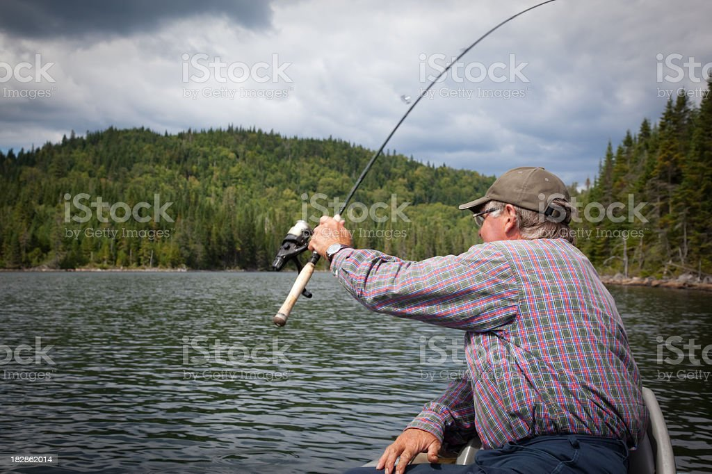 Senior Fisherman on Lake in Summer royalty-free stock photo