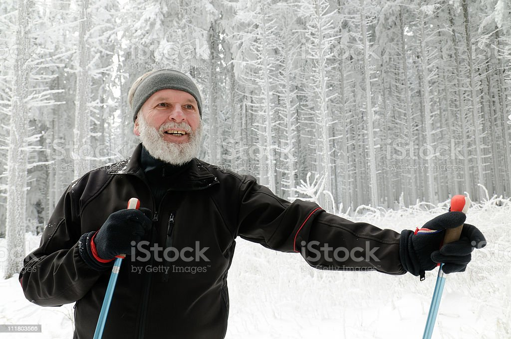 Senior Fitness Training in the winter forest stock photo