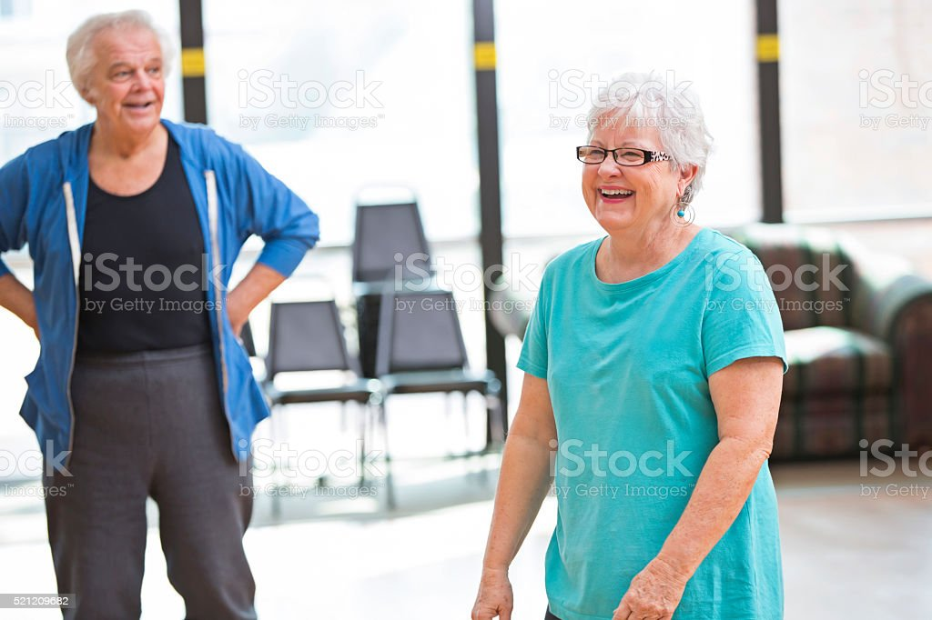 Senior friends have fun before exercise class stock photo