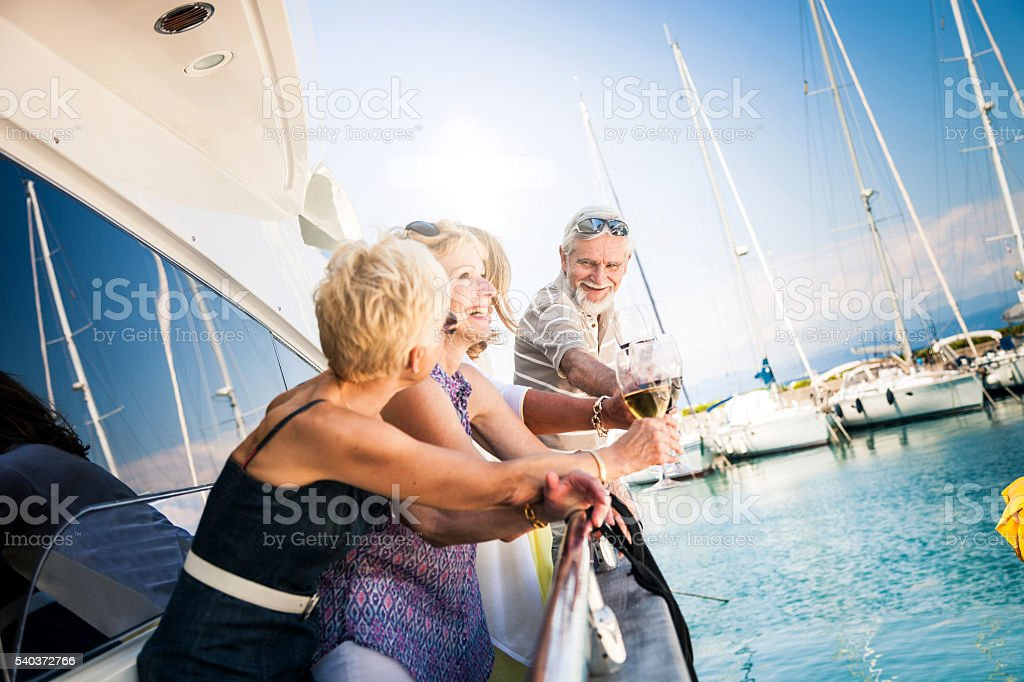 Senior friends having a weekend together on a yacht stock photo