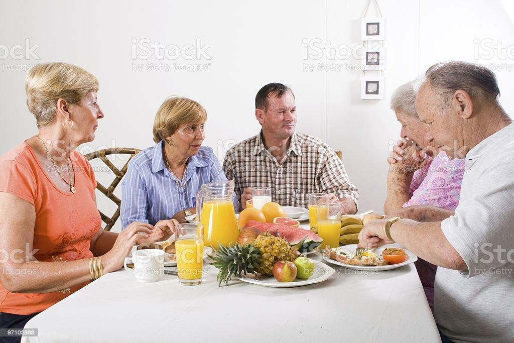 senior friends having breakfast royalty-free stock photo