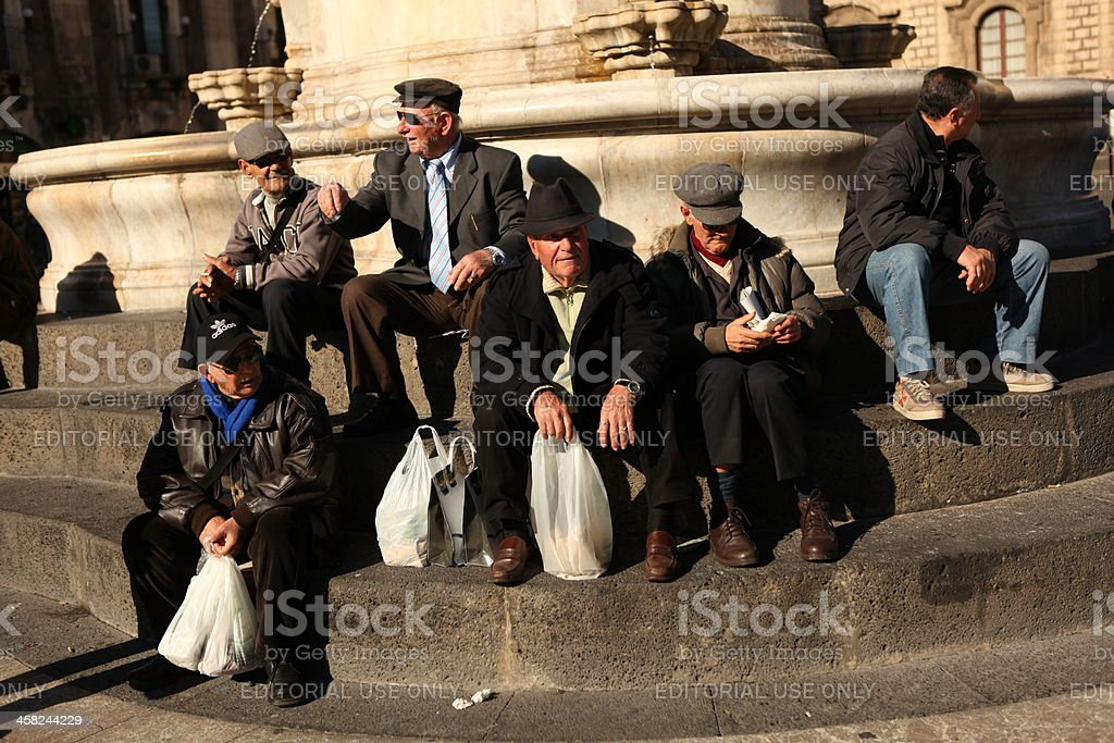 Senior friends in a city square royalty-free stock photo