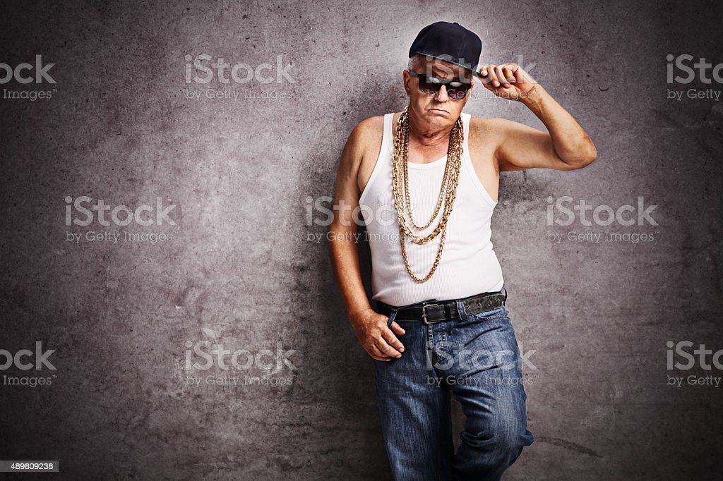 Senior gangster in baggy hip-hop clothes stock photo