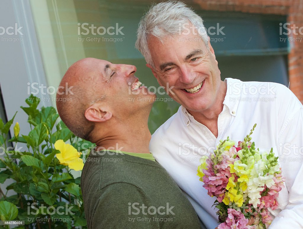 Senior Gay Male Couple with Bouquet of Flowers stock photo