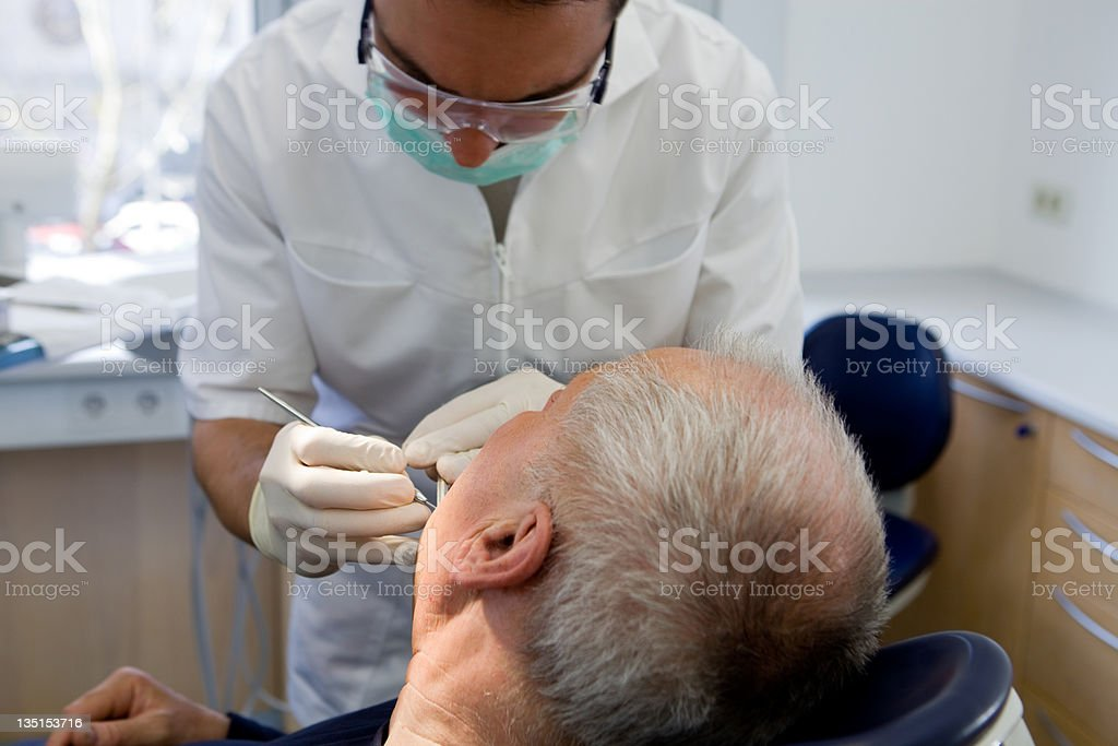 Senior gentleman at the dentist royalty-free stock photo