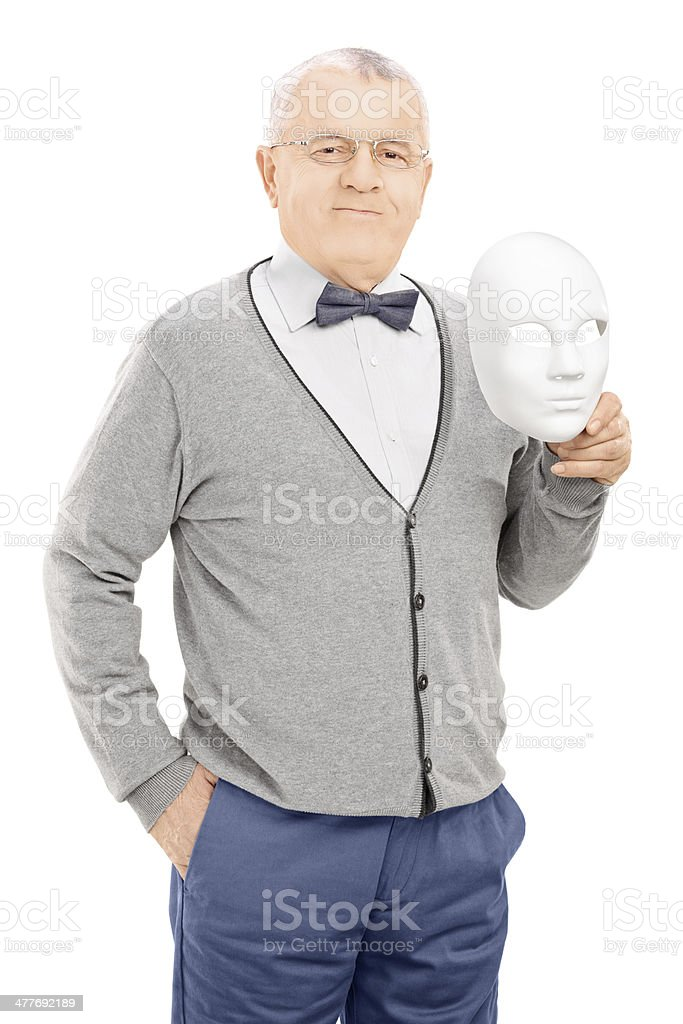 Senior gentleman holding a theater mask royalty-free stock photo