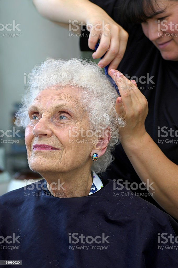 Senior getting hair styled stock photo