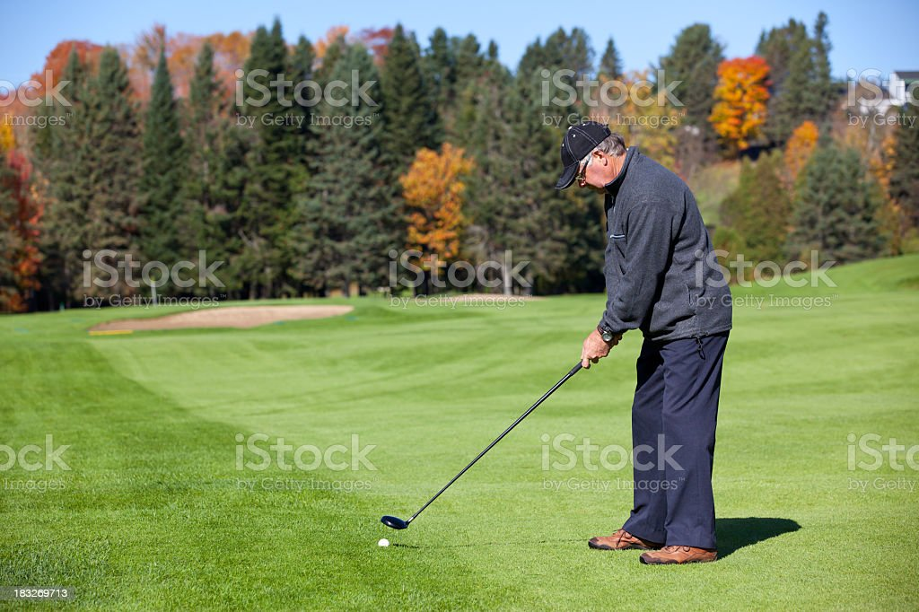 Senior Golf Player in Action in Autumn royalty-free stock photo