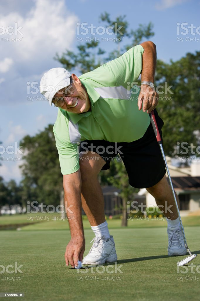 Senior golfer on green royalty-free stock photo