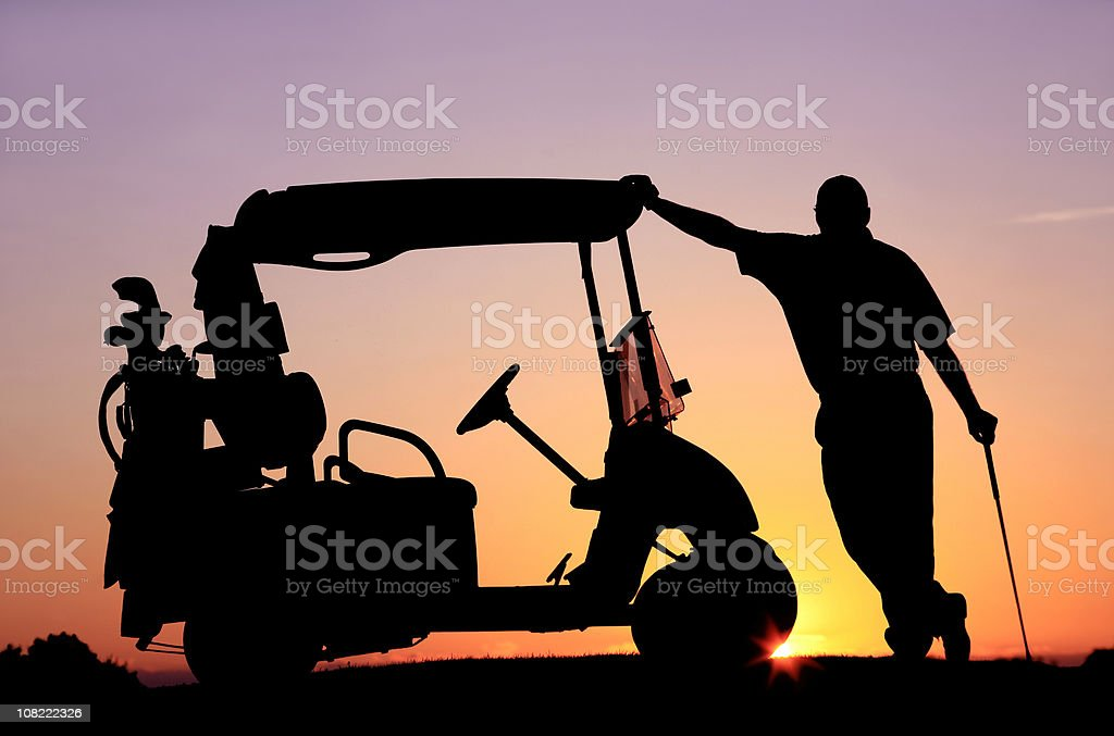Senior Golfer Relaxing By Golf Cart royalty-free stock photo