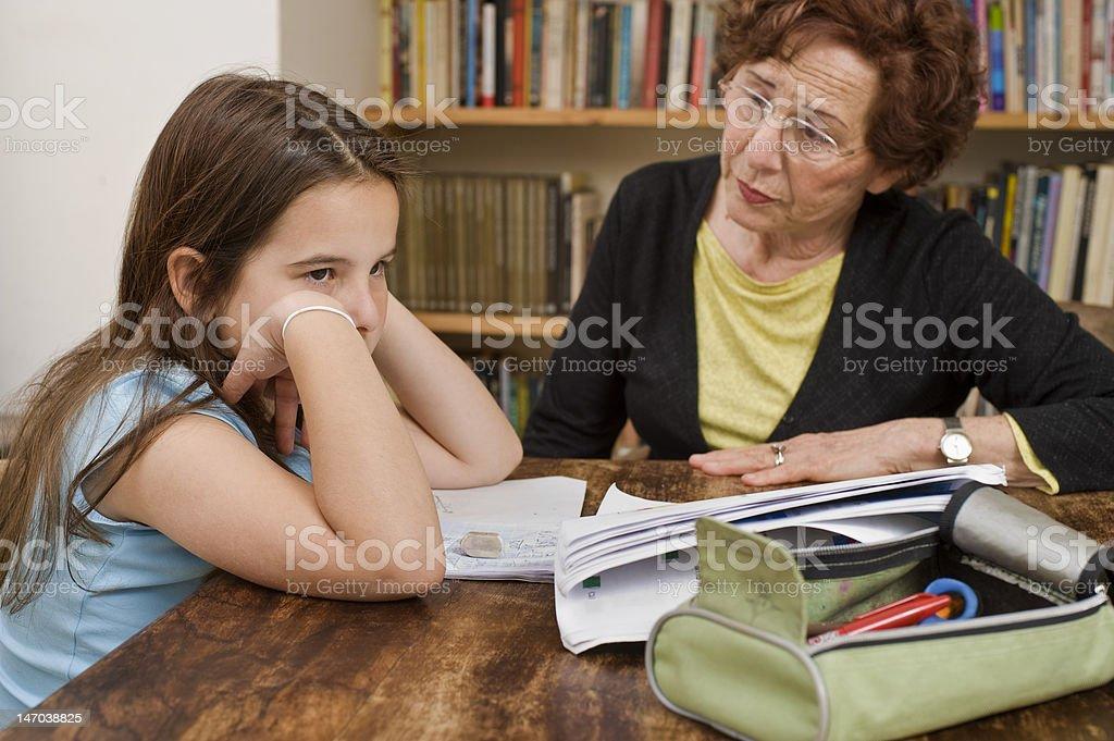 senior halping child doing homework royalty-free stock photo