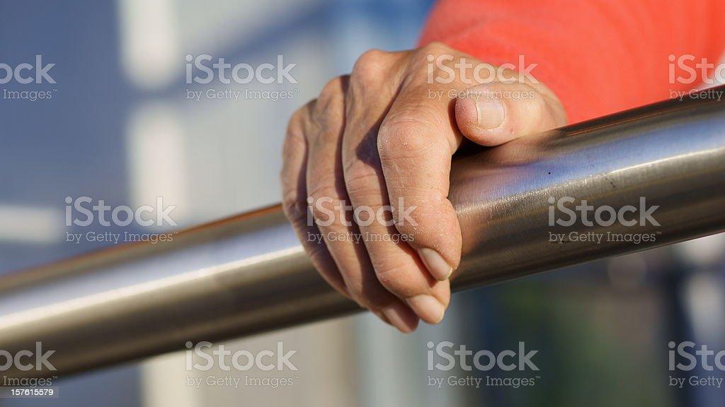 Senior Hand Grasps Stainless Steel Railing royalty-free stock photo