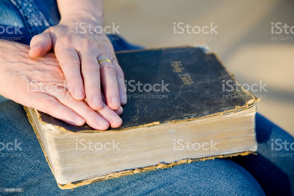 Senior Hands on an Old Bible royalty-free stock photo