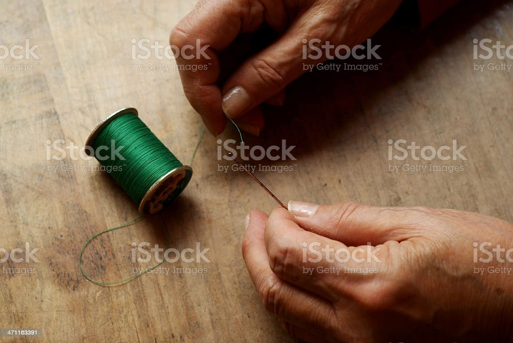 Senior Hands Threading Needle royalty-free stock photo
