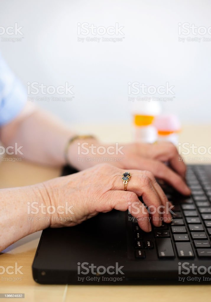 Senior Hands Using a Computer stock photo