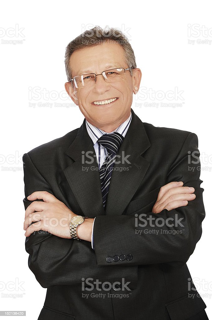 Senior handsome businessman with folded arms and glasses royalty-free stock photo