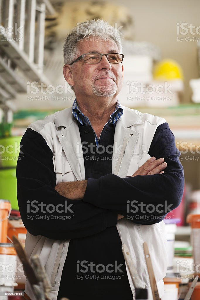 Senior Handyman in a Hardware Store royalty-free stock photo