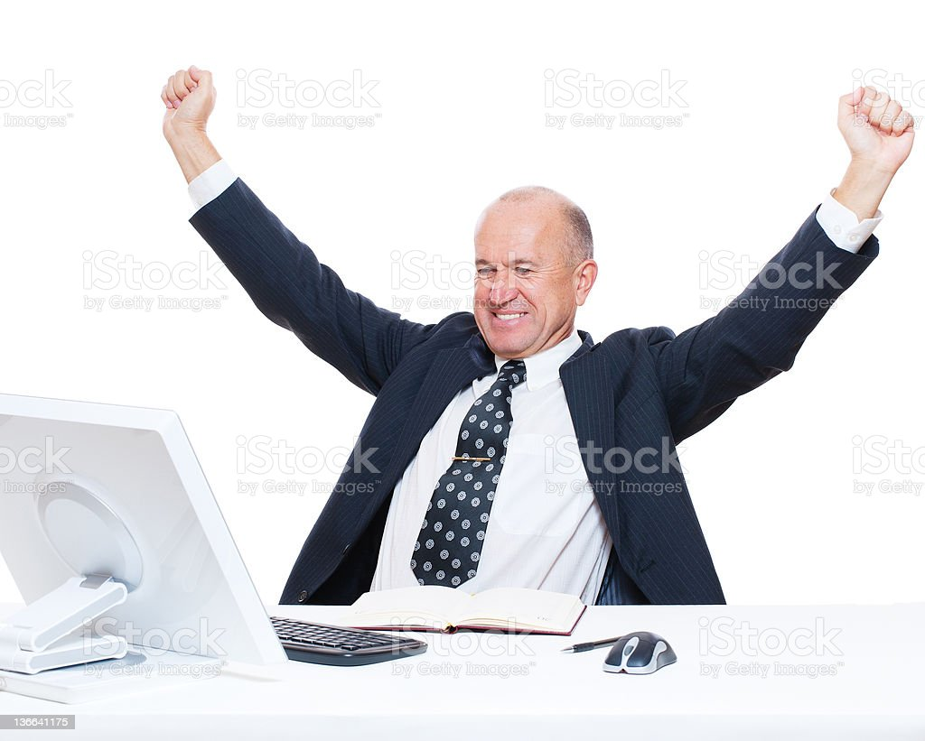 senior happy businessman sitting in workplace royalty-free stock photo