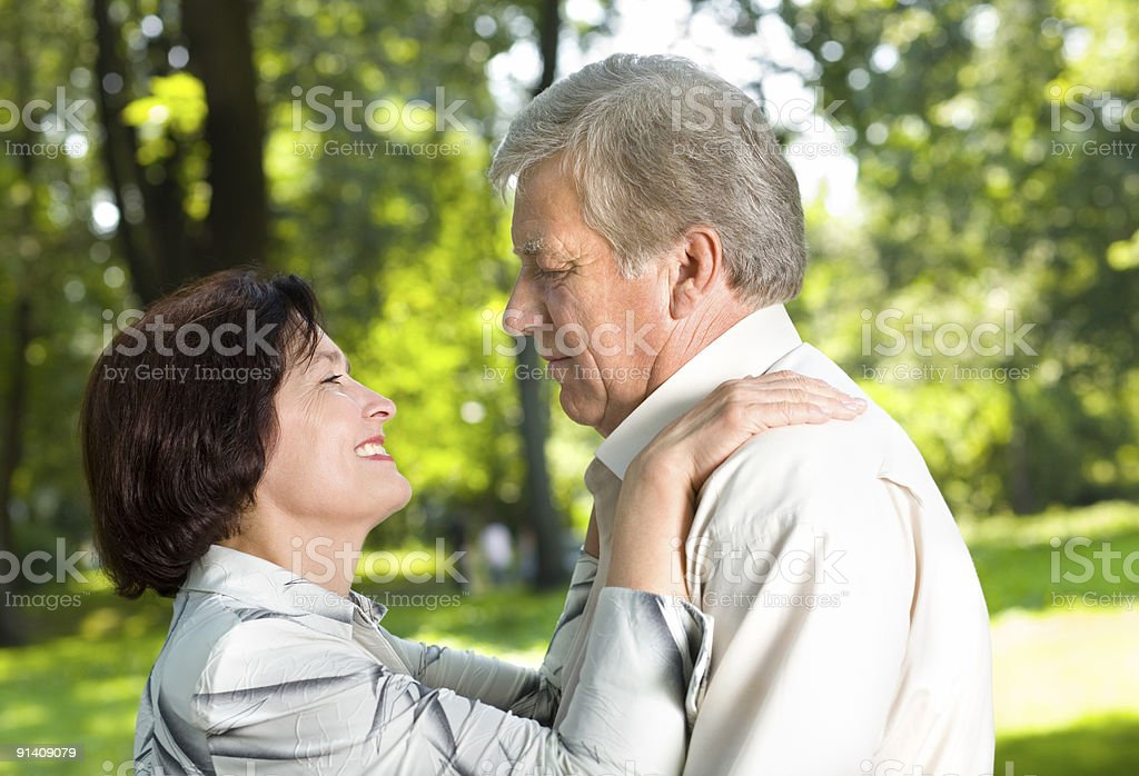 Senior happy couple walking together or dancing outdoors royalty-free stock photo