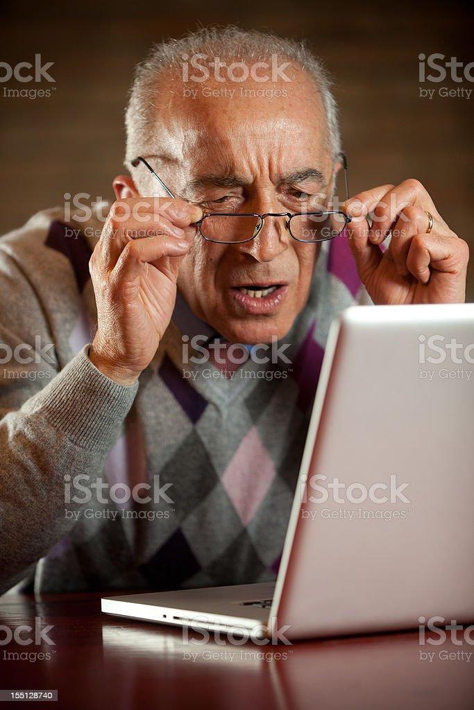 Senior hardly looking at computer royalty-free stock photo