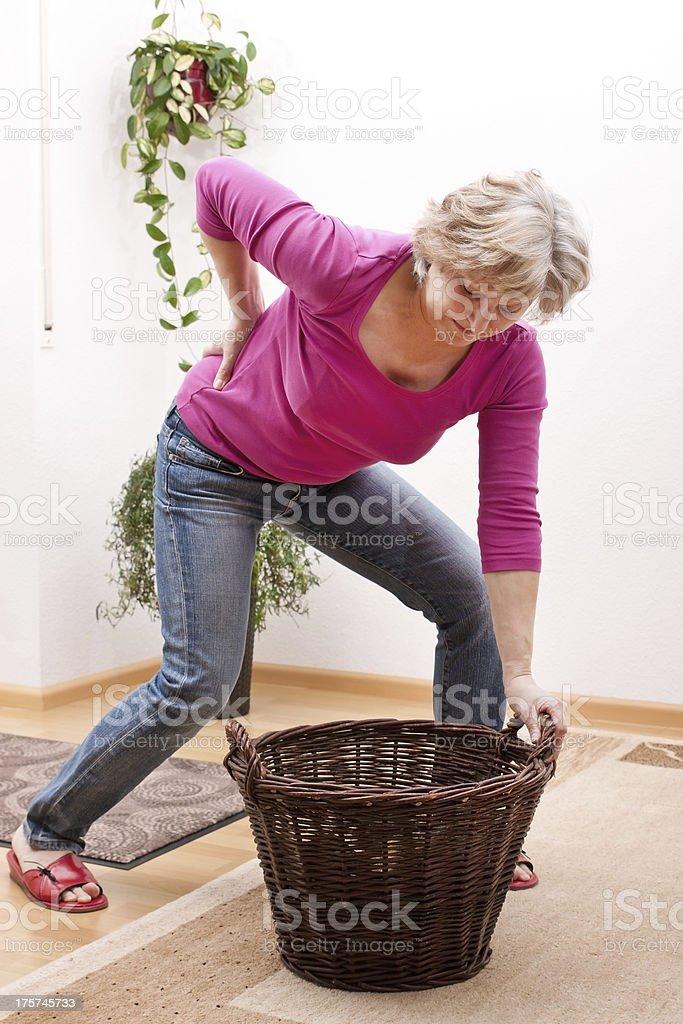 Senior has back pain due to heavy load stock photo