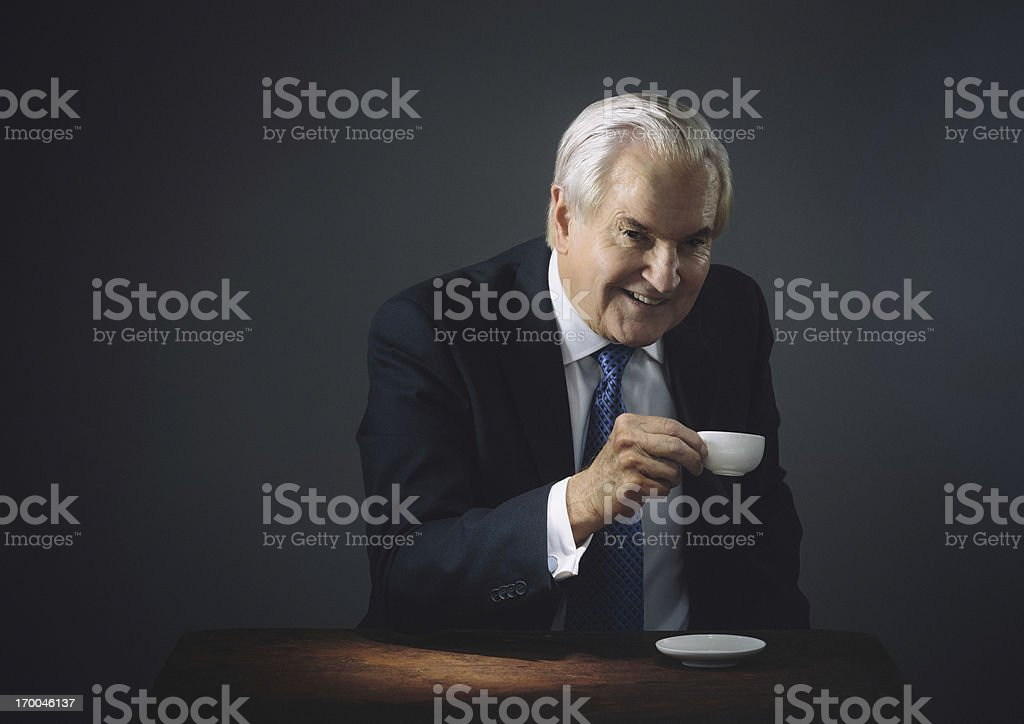 senior having an espresso royalty-free stock photo