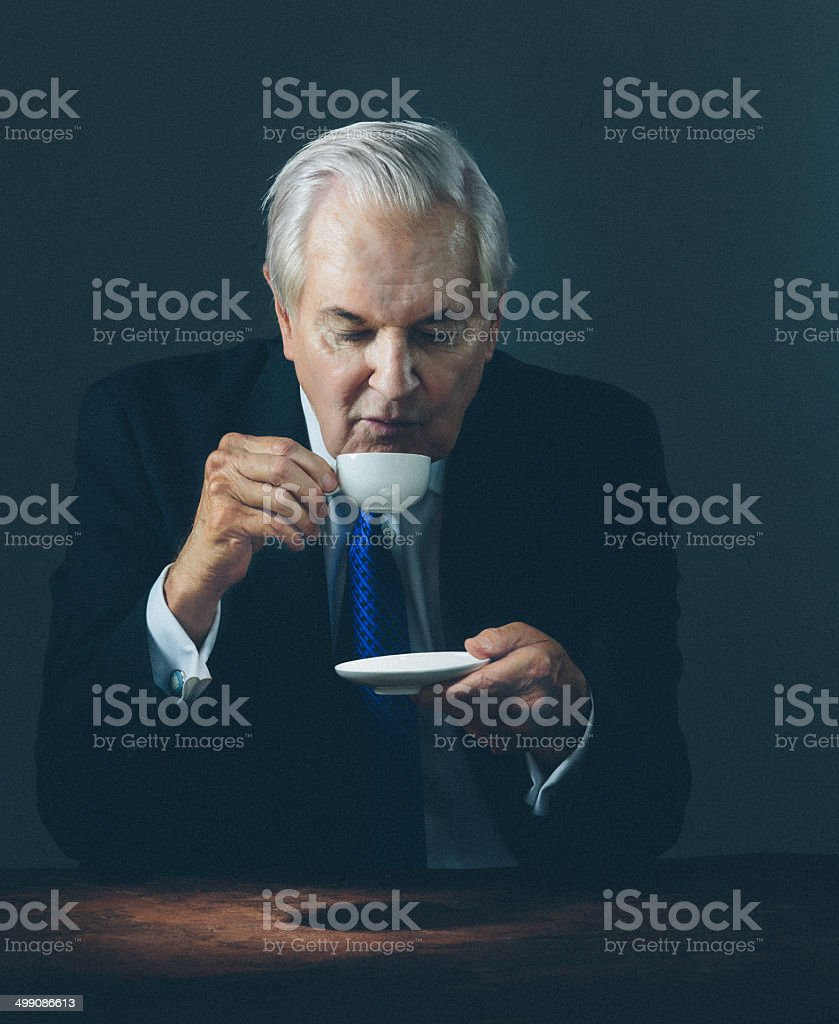 senior having an espresso stock photo