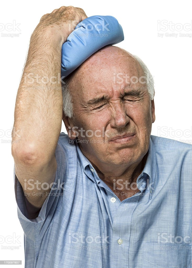 Senior having terrible headache royalty-free stock photo