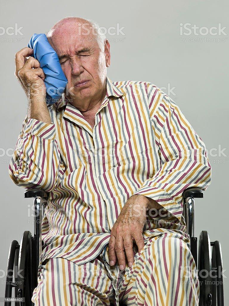 Senior having terrible headache royalty-free stock photo