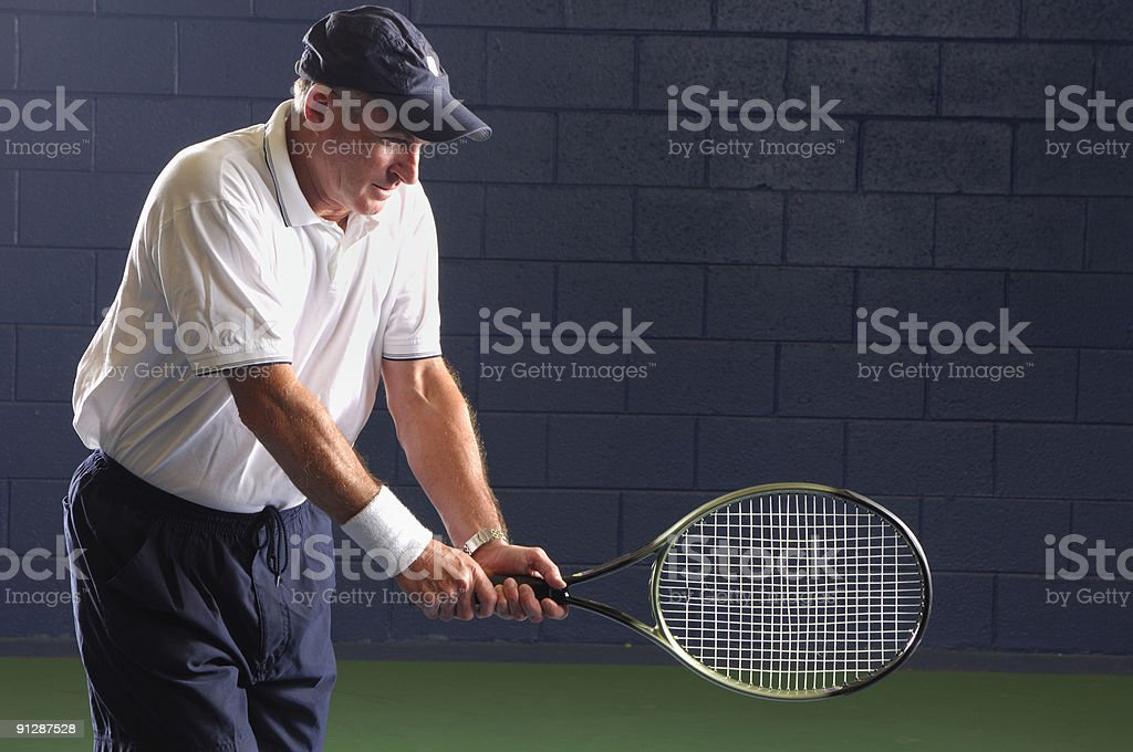 Senior Health and Fitness Tennis Swing royalty-free stock photo