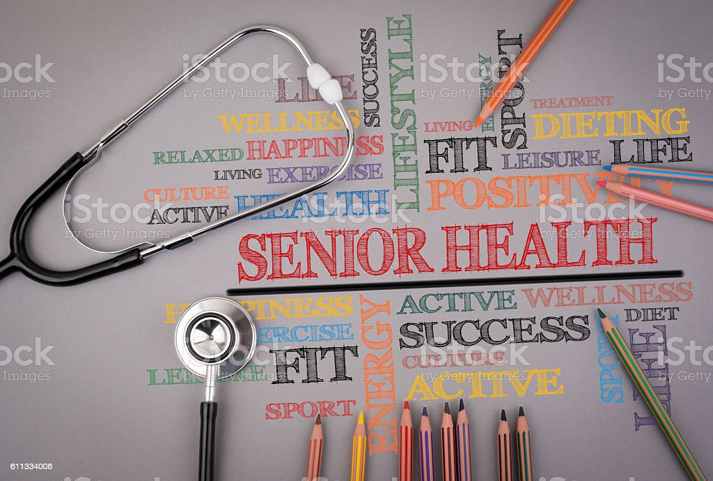 Senior Health. Colored pencils and a stetoscope on the table stock photo