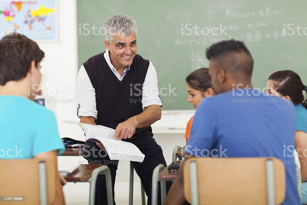 senior high school teacher teaching in classroom stock photo