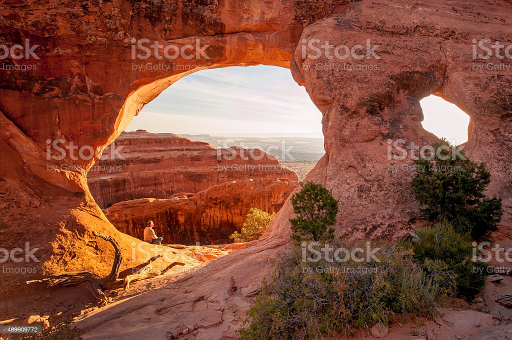 Senior Hiker, Double Arch, Arches National Park, Utah stock photo