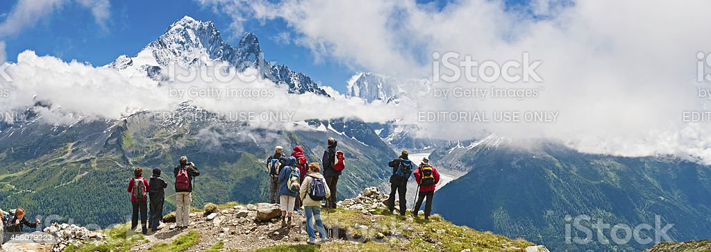 Senior hikers looking over Alpine panorama Mont Blanc France royalty-free stock photo