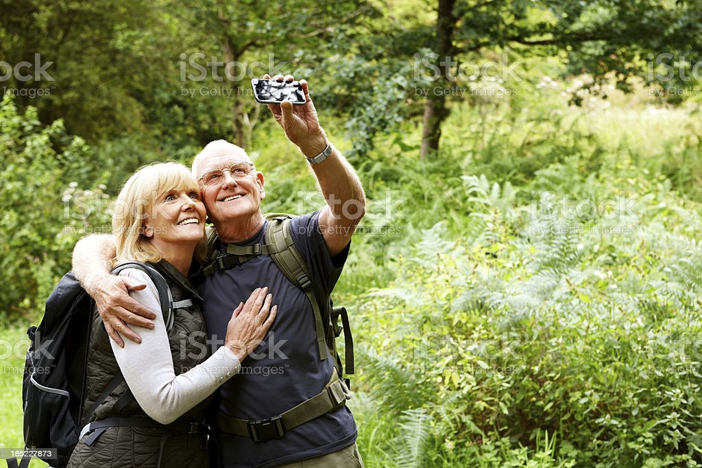 Senior hikers taking their self portrait stock photo