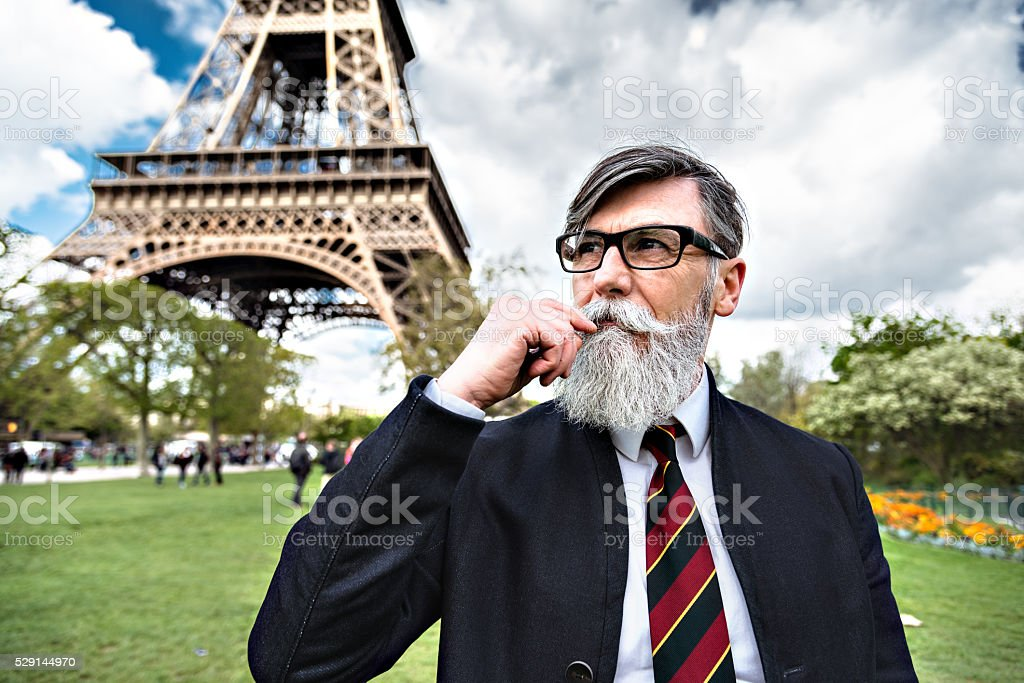 Senior hipster business man portrait under the tour eiffel stock photo