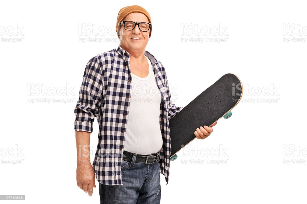 Senior hipster holding a skateboard stock photo