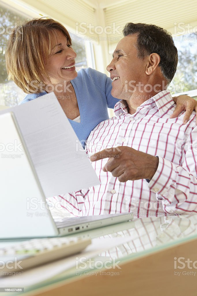 Senior Hispanic Couple Working In Home Office royalty-free stock photo