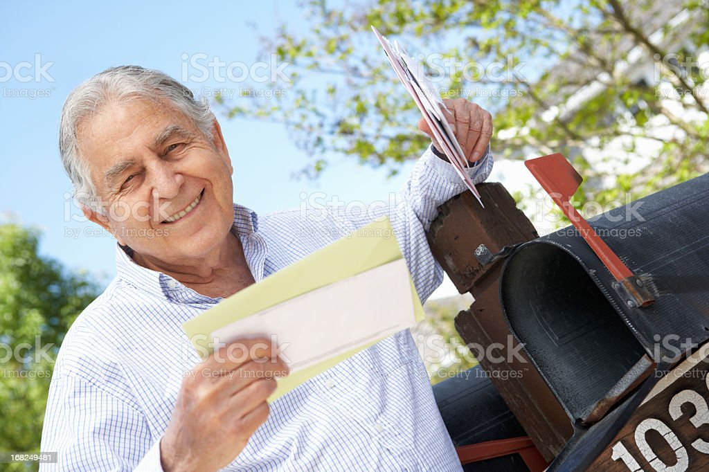 Senior Hispanic Man Checking Mailbox royalty-free stock photo