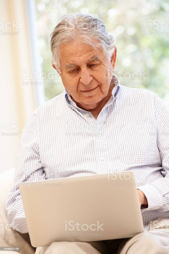 Senior Hispanic man with laptop royalty-free stock photo