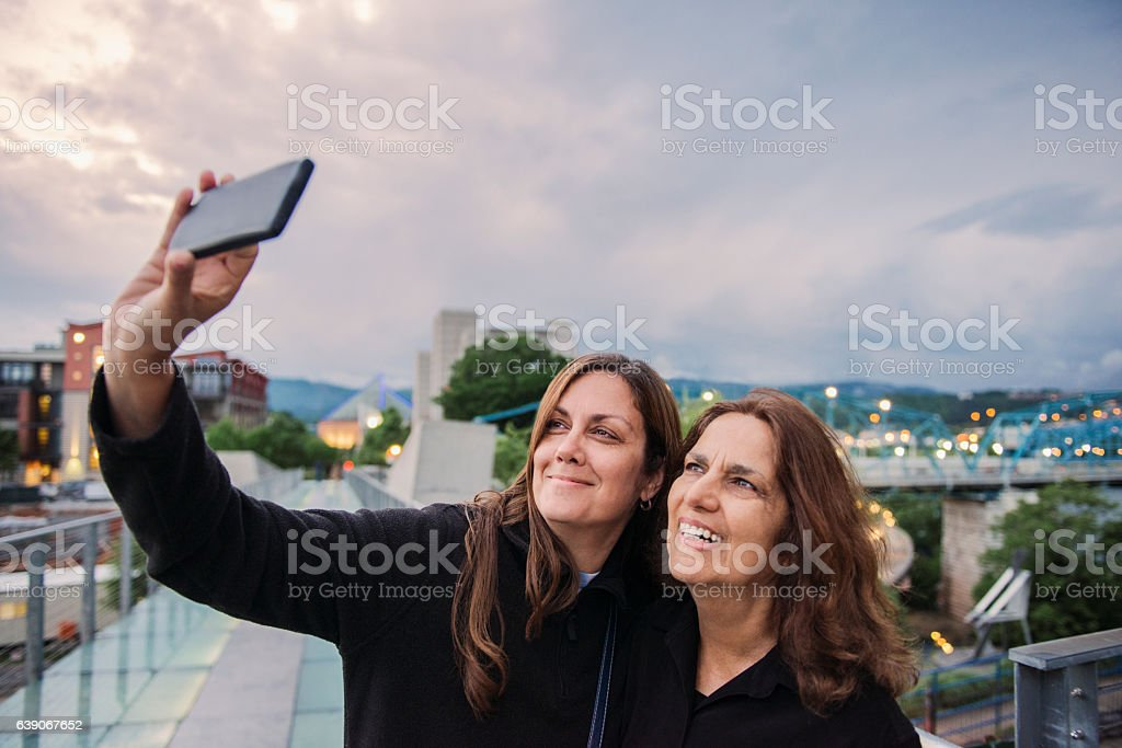 Senior Hispanic Mother and Mature Daughter Taking Selife Chattanooga Tennessee stock photo